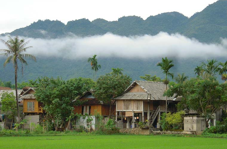 Mai Chau balmboo house under the mist