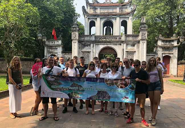 tourists visit hanoi temple of literature