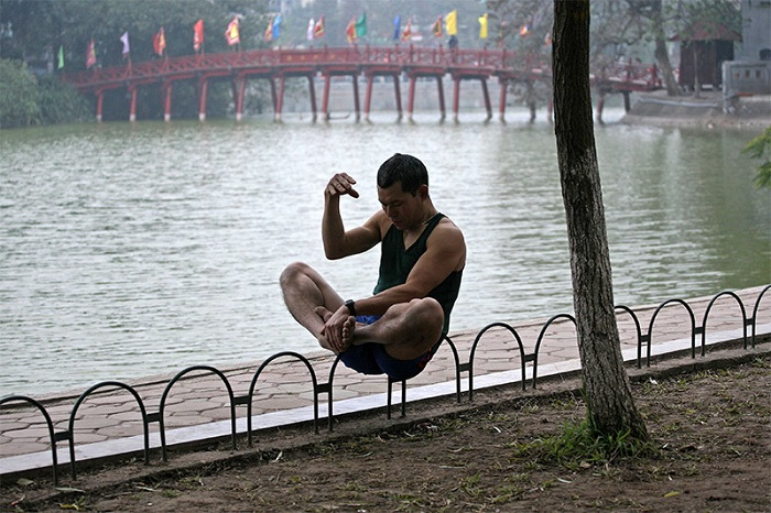 visit hanoi in early morning a man in the lake